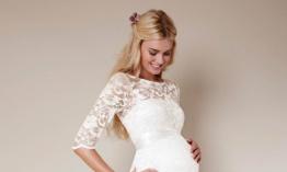Mujer embarazada con vestido de novia